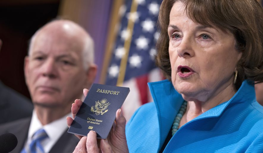 Senate Intelligence Committee Vice Chair Dianne Feinstein, California Democrat, joined by Sen. Ben Cardin, Maryland Democrat, points to the embedded chip in her passport that contains digital information, as she and other Democrats talk about security measures for Syrian refugees and others coming into the U.S. on Nov. 19, 2015, during a news conference on Capitol Hill in Washington. (Associated Press) **FILE**