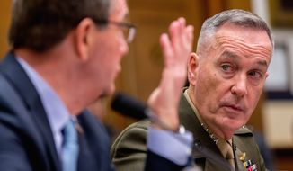 Joint Chiefs Chairman Gen. Joseph Dunford Jr. (right) listens at right as Defense Secretary Ashton Carter testifies before the House Armed Services Committee on Tuesday on Capitol Hill. (Associated Press)