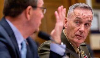 Joint Chiefs Chairman Gen. Joseph Dunford Jr. listens at right as Defense Secretary Ash Carter testifies on Capitol Hill in Washington, Tuesday, Dec. 1, 2015, before the House Armed Services Committee hearing on the U.S. Strategy for Syria and Iraq and its Implications for the Region. (AP Photo/Andrew Harnik)