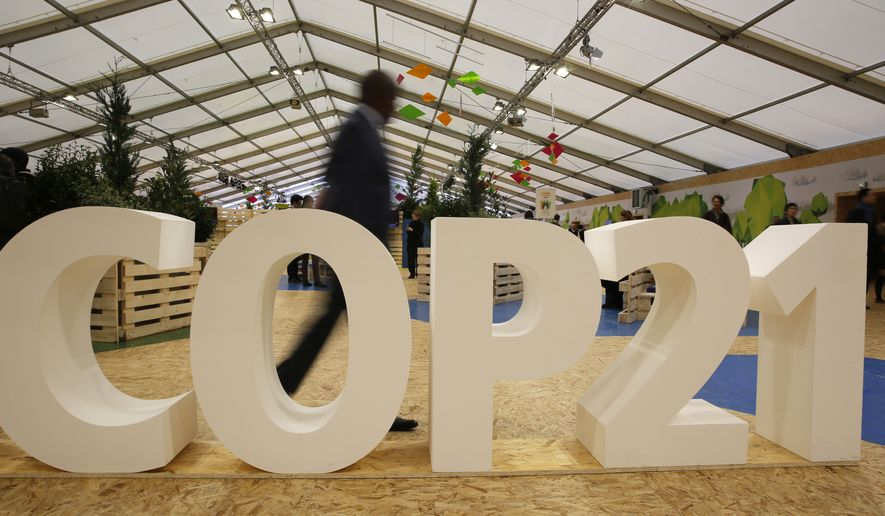 A man visits the Climate Generations Areas, part of the COP21, the United Nations Climate Change Conference Tuesday, Dec. 1, 2015 in Le Bourget, north of Paris.  (AP Photo/Christophe Ena)