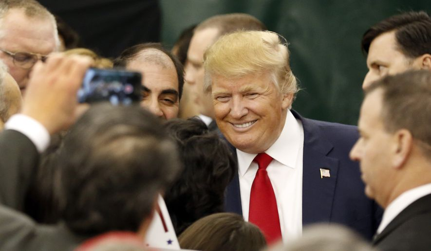 Republican presidential candidate Donald Trump meets voters after speaking during a campaign stop at the White Mountain Athletic Club  Tuesday, Dec. 1, 2015, in Waterville Valley, N.H. (AP Photo/Jim Cole)