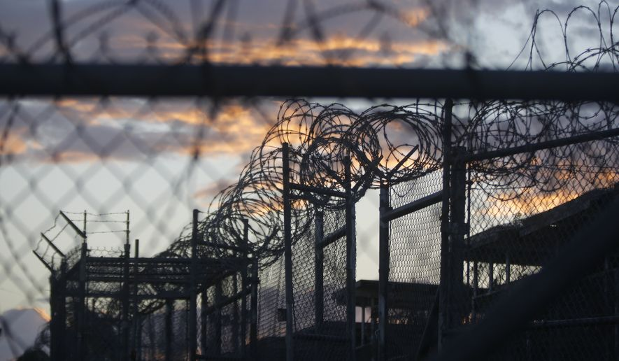 Dawn arrives at the now closed Camp X-Ray at Guantanamo Bay Naval Base, Cuba. Camp X-Ray was used as the first detention facility for al Qaeda and Taliban militants who were captured after the Sept. 11 attacks. (Associated Press)