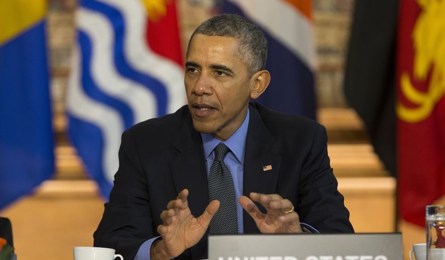 U.S. President Barack Obama speaks during a meeting with heads of state from small island nations most at risk from the harmful effects of climate change, in Paris, on Tuesday, Dec. 1, 2015. (AP Photo/Evan Vucci)