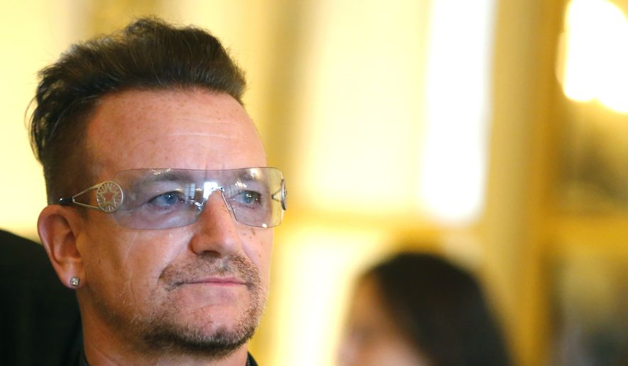 "This July 16, 2013, file photo shows Bono during the ceremony where he was inducted as an ""Officier dans l'Ordre des Arts et Lettres"" (Officer in the Order of Arts and Letters) at the Culture Ministry in Paris. (AP Photo/Jacques Brinon, File)"