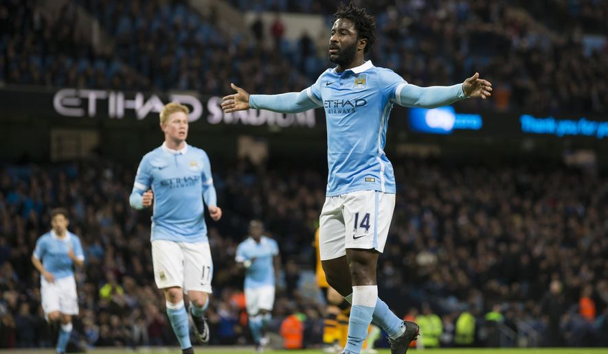 Manchester City's Wilfried Bony celebrates after scoring during the English League Cup soccer match between Manchester City and Hull City at the Etihad Stadium, Manchester, England, Tuesday, Dec. 1, 2015. (AP Photo/Jon Super)