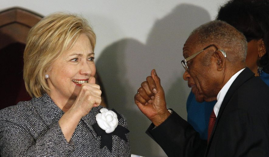 Democratic presidential candidate Hillary Clinton greets and gives a thumbs-up to Fred Gray, Rosa Parks former attorney, before speaking at the Dexter Avenue King Memorial Baptist Church, Tuesday, Dec. 1, 2015, in Montgomery, Ala. (AP Photo/ Hal Yeager) ** FILE **
