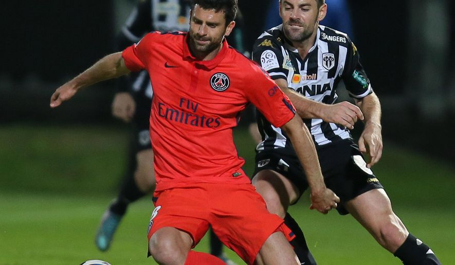 Paris Saint Germain's midfielder Thiago Motta of Italy, challenges for the ball with Angers' midfielder Thomas Mangani during their French League One soccer match, Tuesday, Dec. 1, 2015, in Angers, western France. Match ended on a 0-0 draw. (AP Photo/David Vincent)