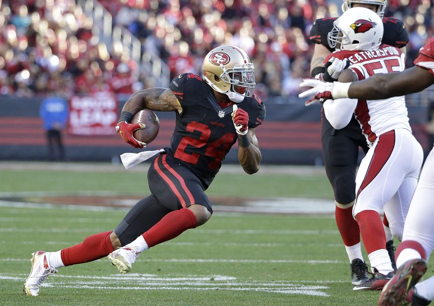 FILE - In this Nov. 29, 2015,  file photo, San Francisco 49ers running back Shaun Draughn (24) runs against the Arizona Cardinals during the second half of an NFL football game in Santa Clara, Calif. In a year of sweeping changes for the San Francisco 49ers, few could have envisioned journeyman running back Shaun Draughn leading the way for the ground game down the stretch this season. Draughn sure showed up at the perfect time, joining his eighth organization in five years. (AP Photo/Marcio Jose Sanchez, File)