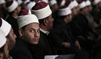 Egyptian Al-Azhar students wait for Sheikh Ahmed el-Tayeb, Grand Imam of Al-Azhar, the pre-eminent institute of Islamic learning in the Sunni Muslim world, to deliver a speech to university students and clerics, at Cairo University, Egypt, Tuesday, Dec. 1, 2015. (AP Photo/Nariman El-Mofty)
