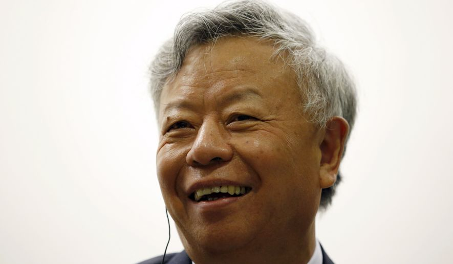 Jin Liqun, president-designate of the Asian Infrastructure Investment Bank (AIIB) smiles during a business meeting in Seoul on Sept. 9, 2015. The inaugural president of a Chinese-led Asian regional bank says the door remains open to the United States and Japan becoming members of the institution. (Associated Press) **FILE**
