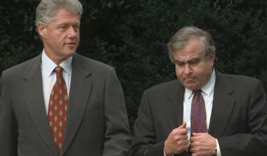 President Clinton talks with National Security Adviser Sandy Berger as the president leaves the White House Tuesday, Oct. 13, 1998, for an education event in Maryland. The president spoke about Kosovo prior to leaving saying he is satified that international monitoring in Kosovo will give NATO leaders the facts they need to decide whether Yugoslav President Milosevic should be spared air attacks to end months of bloody repression in Kosovo. (AP Photo/Susan Walsh)