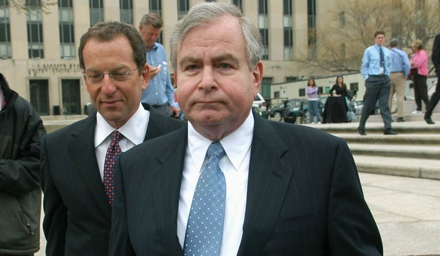 FILE - In this April 1, 2005 file photo, Sandy Berger, who was President Clinton's top national security aide, leaves the U.S. District Court House in Washington. A spokesman for his firm says that Berger, who helped craft President Bill Clinton's second term foreign policy and got in trouble over mishandling classified documents, died Wednesday. (AP Photo/Kevin Wolf, File)