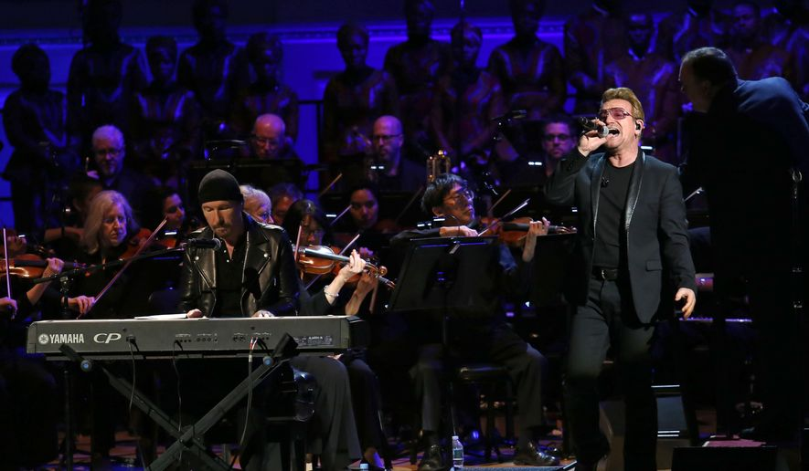 "Bone, right, and The Edge perform at ""It Always Seems Impossible Until It Is Done: A Night of Music with ONE and (RED)"", in celebration of World AIDS Day, at Carnegie Hall on Tuesday, Dec. 1, 2015, in New York. (Photo by Greg Allen/Invision/AP)"