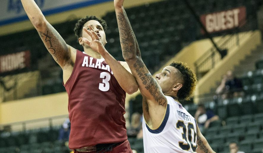 Alabama forward Michael Kessens (3) shoots over Notre Dame forward Zach Auguste (30) during the second half of an NCAA college basketball game Sunday, Nov. 29, 2015, in Orlando, Fla. (AP Photo/Willie J. Allen Jr.)