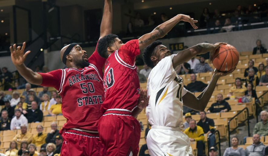 Missouri's K.J. Walton, right, pulls down a rebound past Arkansas State's Frederic Dure, center, and Anthony Livingston (50) during the first half of an NCAA college basketball game Tuesday, Dec. 1, 2015, in Columbia, Mo.  (AP Photo/L.G. Patterson)