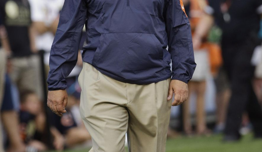 FILE - In this Aug.13, 2015, file photo, Chicago Bears defensive coordinator Vic Fangio watches the team during warmups before an NFL preseason football game against the Miami Dolphins in Chicago. Fangio coordinated a defense in San Francisco that ranked among the league's best the past four years and he's overseeing quite a turnaround in Chicago. His past and present will collide when the 49ers visit the Bears on Sunday, Dec. 6. (AP Photo/Nam Y. Huh, File)