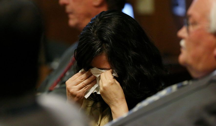 Sophia Richter, right, wipes her eyes with a tissue as the state prosecutors deliver their closing arguments during her and her husband Fernando Richter's trial at Pima County Superior Court Wednesday, Dec. 2, 2015, in Tucson, Ariz. The Richters face charges of child abuse and kidnapping, and Fernando Richter faces two additional charges of aggravated assault with a deadly weapon. (Mike Christy/Arizona Daily Star via AP)  ALL LOCAL TELEVISION OUT; PAC-12 OUT; MANDATORY CREDIT; GREEN VALLEY NEWS OUT; MANDATORY CREDIT