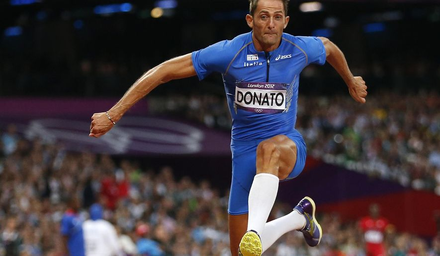 CORRECTS THAT ALEX SCHWAZER WAS CLEARED IN THIS CASE ** FILE - In this Thursday, Aug. 9, 2012 file photo, Italy's Fabrizio Donato competes in the men's triple jump final during the athletics in the Olympic Stadium at the 2012 Summer Olympics, London. The Italian Olympic Committee has requested two-year doping bans for 26 track and field athletes, several of whom are slated to compete at next year's Rio de Janeiro Games. The list includes Fabrizio Donato, the bronze medalist in triple jump at the 2012 London Olympics; Andrew Howe, the silver medalist in long jump at the 2007 world championships. Alex Schwazer, the gold medalist in 50-kilometer race walk at the 2008 Beijing Olympics who was banned previously, was among 39 athletes cleared in this case. (AP Photo/Matt Dunham, File)