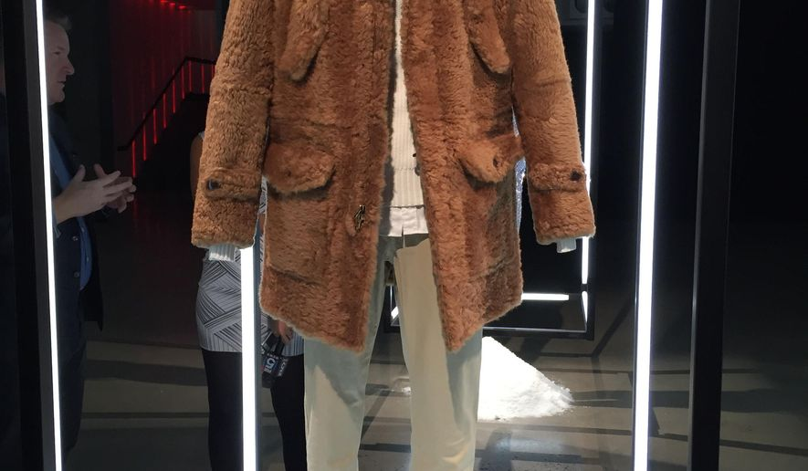 "CORRECTS DESIGNER TO TODD SNYDER - A luscious merino shearling coat designed by Todd Snyder, inspired by the film, ""Star Wars: The Force Awakens,"" is displayed at a gallery on Wednesday, Dec. 2, 2015, in New York. Fashion designers created outfits that pays homage to characters from the film as part of the ""Force 4 Fashion,"" initiative. The outfits will be auctioned off with proceeds going to the Child Mind Institute. (AP Photo/Jocelyn Noveck)"