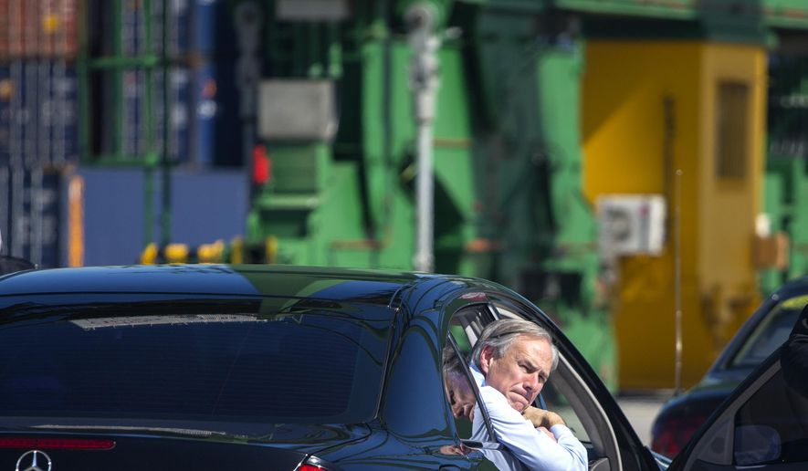 Texas Gov. Greg Abbott looks out from a car during his visit to the Special Development Zone of Mariel, within the Mariel free trade zone in the Bay of Mariel, Cuba, Tuesday, Dec. 1, 2015. Abbott is on a two-day visit to Cuba with a business delegation looking to reintroduce Texas agricultural products to a growing Cuban market. (AP Photo/Desmond Boylan)