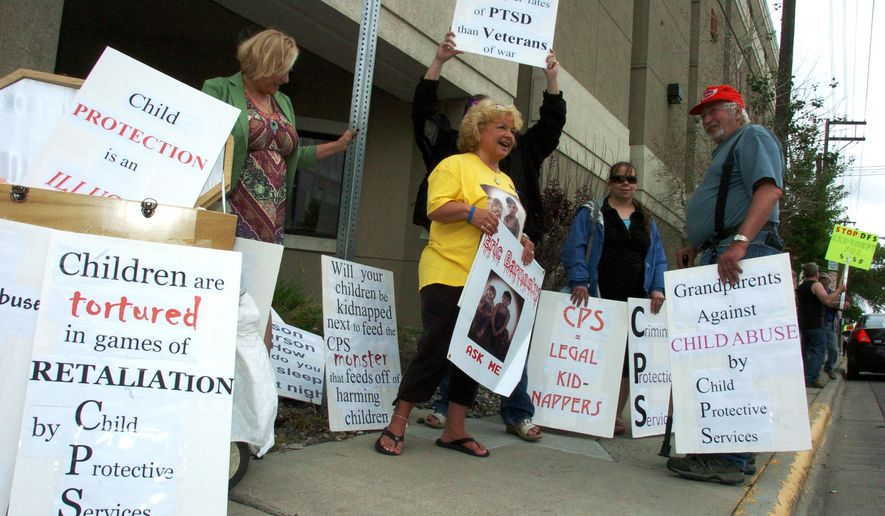 FILE - In this June 5, 2015, file photo, Patsy Fercho, center, protests outside the Montana Department of Public Health and Human Services office in Billings, Mont., with others who are upset about how the Division of Child and Family Services handles placement of children in abuse and neglect cases. The attorney for Montana grandmother  Patsy Fercho says a Bureau of Indian Affairs officer helped execute an out-of-state court warrant that ordered Fercho, who was hiding on the Northern Cheyenne Indian Reservation, to turn her grandsons back over to their father. The tribal court had ordered the children into their grandmother's custody over concerns they were being abused. Fercho is not a tribal member. (AP Photo/Matthew Brown, File)