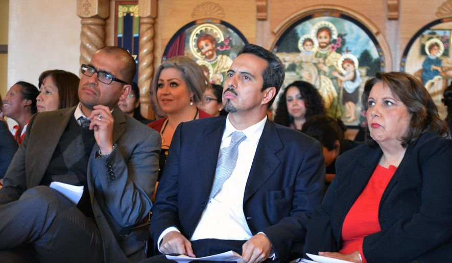 New Mexico Rep. Javier Martinez, D-Albuquerque, left, Rep. Antonio Maestas, D- Albuquerque, center, and advocate Veronica Garcia sit at a news conference announcing new efforts to push early childhood education in Albuquerque, N.M. on Tuesday, Dec. 1, 2015. Democrats and a coalition of 40 groups say they will push again for legislation that would tap into New Mexico's permanent land fund to expand early child education. (AP Photo/Russell Contreras)