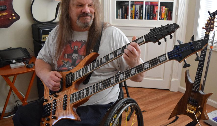ADVANCE FOR WEEKEND EDITIONS, DEC. 5-6 - In  this photo taken Nov. 11, 2015,  Jerry Swanson plays his double-necked combination six-string/bass guitar in Beloit, Wis. Swanson makes custom guitars in the workshop behind his home. (Erica Pennington/The Beloit Daily News via AP) MANDATORY CREDIT