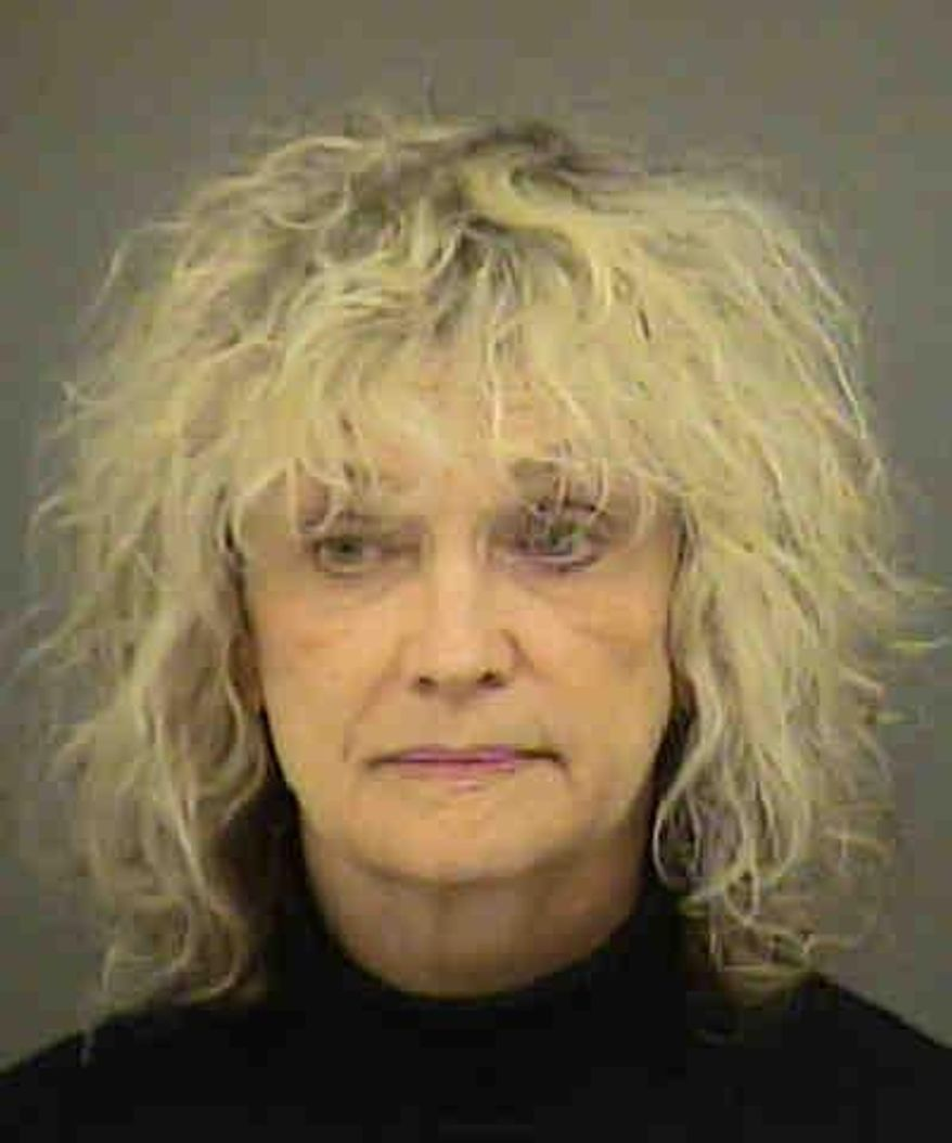 This booking photo provided by the Mecklenburg County Sheriff's Office shows Joanne Snow. Snow, an American Airlines flight attendant accused of attacking fellow crew members and two U.S. air marshals during a trans-Atlantic flight, made her first court appearance on Tuesday, Dec. 1, 2015, where attorneys argued over whether she should be held in custody or released to her family. (Mecklenburg County Sheriff's Office via AP)