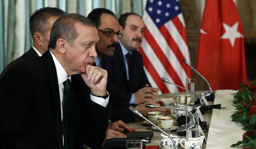 Turkish President Recep Tayyip Erdogan, left, listens to President Barack Obama during a bilateral meeting in Paris, France, Tuesday, Dec. 1, 2015. The leaders discussed the continuing crisis in Syria, and the fight against the Islamic State group. (AP Photo/Yasin Bulbul, Presidential Press Service, Pool)