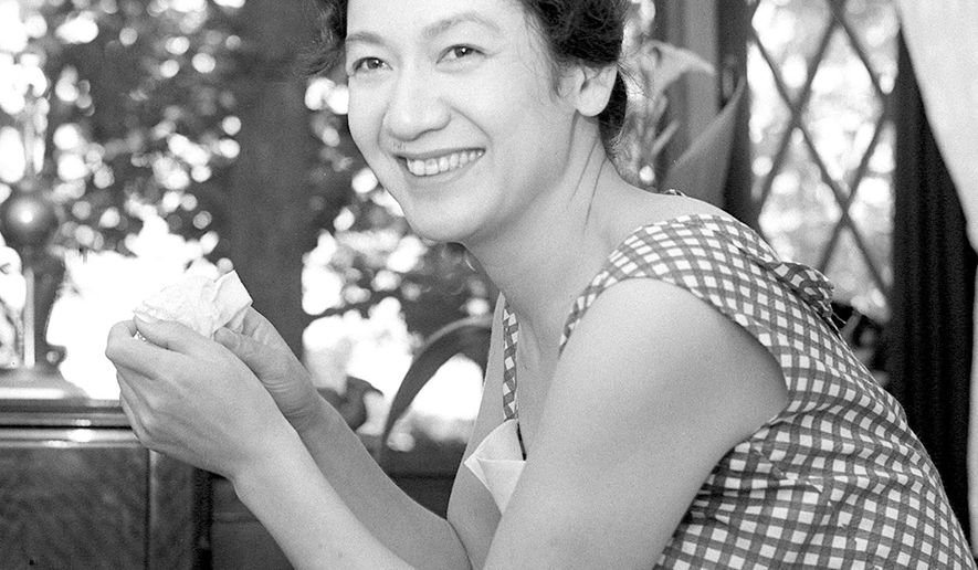"""In this photo taken in 1960, Japanese actress Setsuko Hara poses in Tokyo. In a last act precisely in keeping with her zeal for privacy, actress Hara, star of director Yasujiro Ozu's """"Tokyo Story"""" and many other Japanese classics, died Sept. 5, 2015 but kept the news quiet until recently. She was 95. (Kyodo News via AP) JAPAN OUT, MANDATORY CREDIT"""