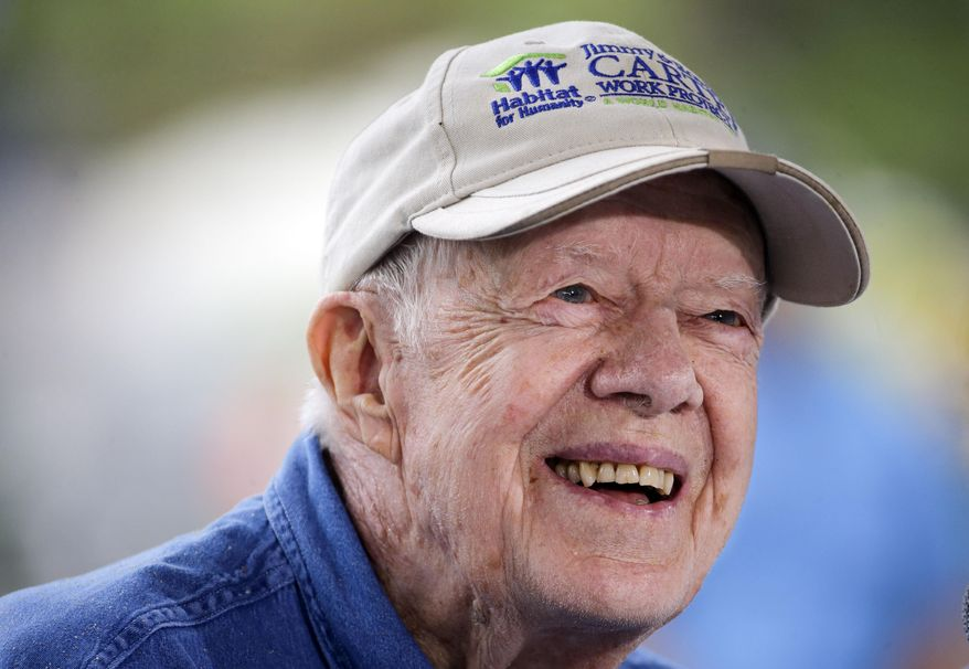 FILE - In a Monday, Nov. 2, 2015 file photo, former President Jimmy Carter answers questions during a news conference at a Habitat for Humanity building site, in Memphis, Tenn. Jimmy Carter's grandson Jason Carter said Wednesday, Dec. 2, 2015, the 91-year-old former president is doing well while undergoing cancer treatment and showing no sign of slowing down, despite his pledge to do just that. (AP Photo/Mark Humphrey, File)