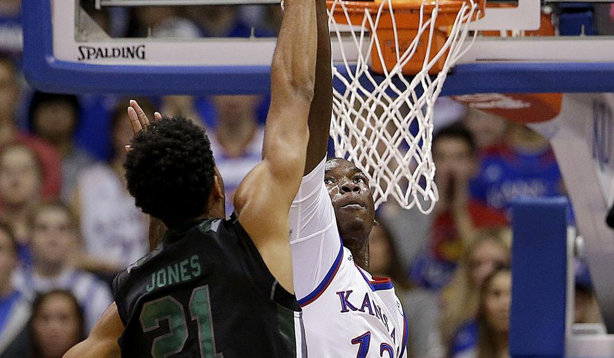 Kansas' Cheick Diallo (13) blocks a shot by Loyola's Jarred Jones (21) during the first half of an NCAA college basketball game Tuesday, Dec. 1, 2015, in Lawrence, Kan. (AP Photo/Charlie Riedel)