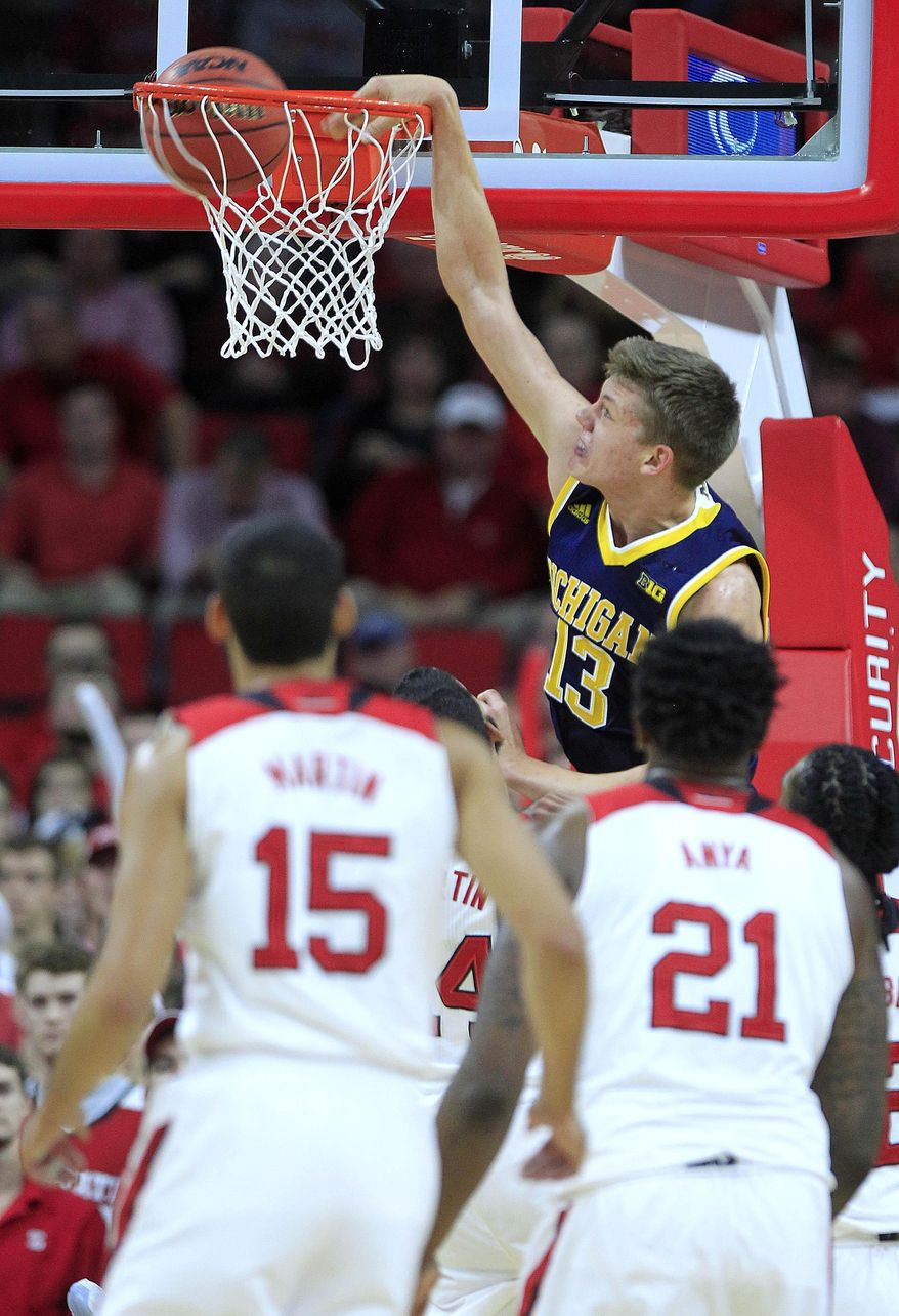 Michigan's Moritz Wagner (13) slams in two during the first half of an NCAA college basketball game against North Carolina State in Raleigh, N.C., Tuesday, Dec. 1, 2015. (Ethan Hyman/The News & Observer via AP)