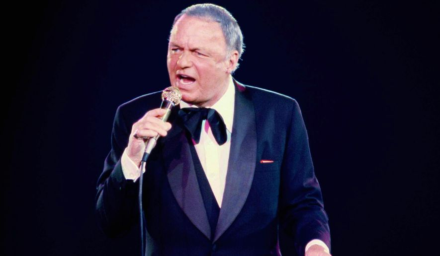 FILE - In this June 23, 1979 file photo, singer Frank Sinatra performs during his concert at the Nassau Coliseum, in Uniondale, N.Y. 100 is turning out to be a very good year for Sinatra. Wednesday night, Dec. 2, 2015, his birthday gets the star treatment with a live Grammy-produced concert at the Wynn resort-casino in Las Vegas. The two-hour concert airs Sunday from 9 to 11 p.m. EST/PST on CBS. (AP Photo/Richard Drew, File)
