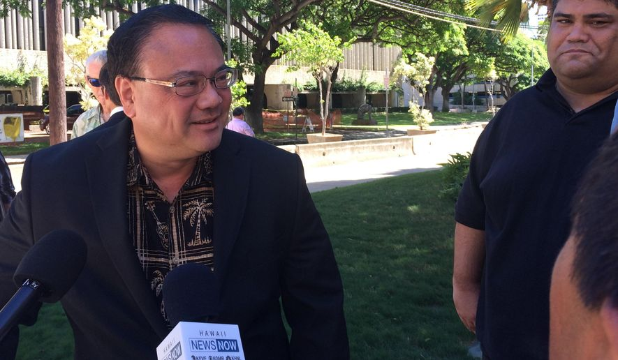 FILE - In this Oct. 23, 2015, file photo, Kelii Akina, left, the president of public policy think-tank Grassroot Institute of Hawaii and a plaintiff in a lawsuit challenging a Native Hawaiian election, speaks to reporters outside U.S. District Court in Honolulu. The U.S. Supreme Court on Wednesday, Dec. 2, 2015, blocked votes from being counted in a unique election that's considered a major step toward self-governance for Native Hawaiians. (AP Photo/Audrey McAvoy, File)