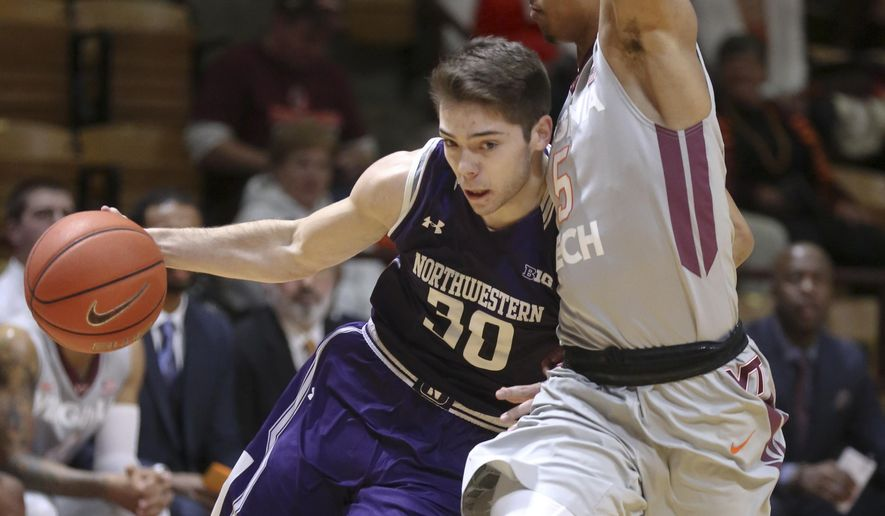 Northwestern's Bryant McIntosh (30) drives past Virginia Tech's Justin Robinson (5) in first half of an NCAA college basketball game in Blacksburg, Va., Tuesday, Dec. 1 2015. (Matt Gentry/The Roanoke Times via AP) LOCAL TELEVISION OUT; SALEM TIMES REGISTER OUT; FINCASTLE HERALD OUT;  CHRISTIANBURG NEWS MESSENGER OUT; RADFORD NEWS JOURNAL OUT; ROANOKE STAR SENTINEL OUT; MANDATORY CREDIT