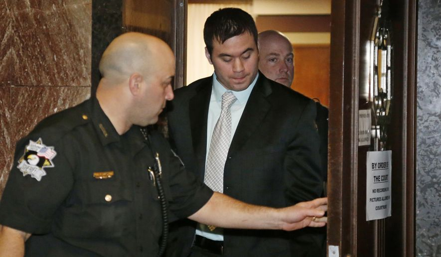 Daniel Holtzclaw, center, is escorted from a courtroom in Oklahoma City, Tuesday, Dec. 1, 2015. Holtzclaw, a former Oklahoma City police officer, is facing dozens of charges alleging he sexually assaulted 13 women while on duty. (AP Photo/Sue Ogrocki) ** FILE **
