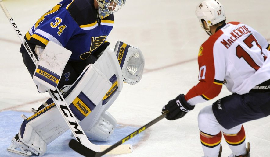 St. Louis Blues' goalie Jake Allen (34) blocks a shot by Florida Panthers' Derek MacKenzie (17) during the second period of an NHL hockey game, Tuesday, Dec. 1, 2015, in St. Louis. (AP Photo/Bill Boyce)