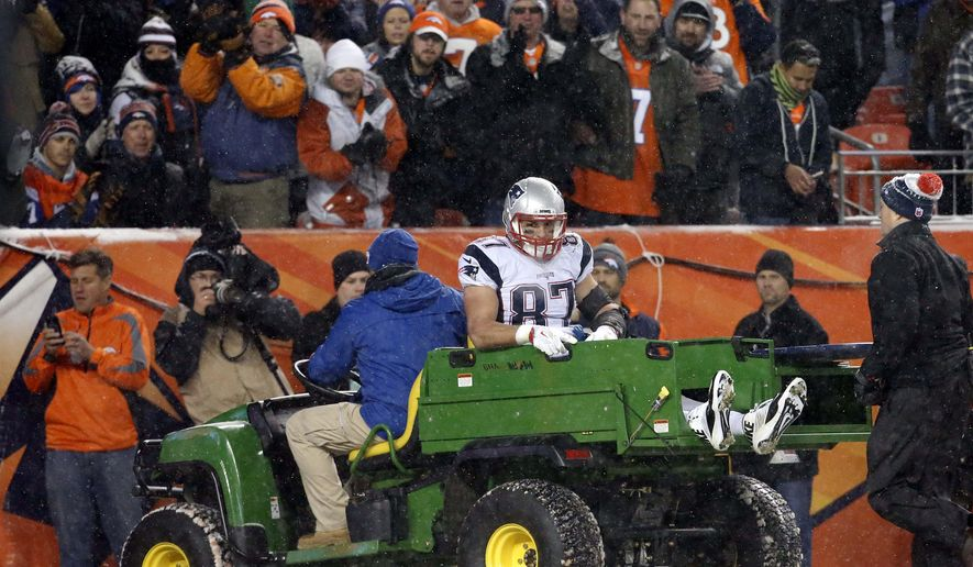 Fans cheer on New England Patriots tight end Rob Gronkowski (87) as he is carted off the field after being injured against the Denver Broncos, Sunday, Nov. 29, 2015, in Denver. The Broncos defeated the Patriots 30-24. (AP Photo/Joe Mahoney)