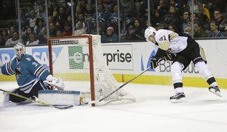 Pittsburgh Penguins' Evgeni Malkin (71) scores past San Jose Sharks goalie Martin Jones during the second period of an NHL hockey game Tuesday, Dec. 1, 2015, in San Jose, Calif. (AP Photo/Marcio Jose Sanchez)