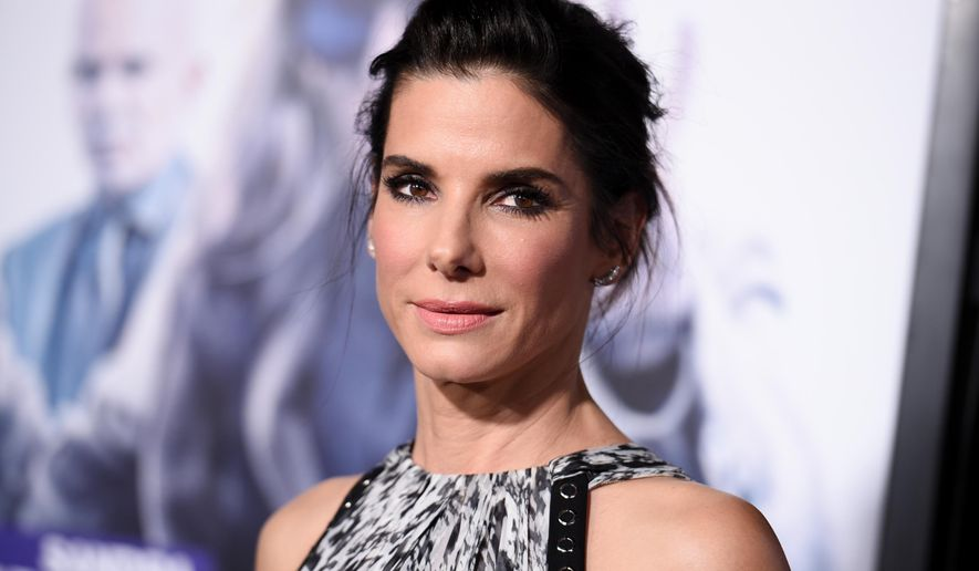 "FILE - In this Oct. 26, 2015 file photo, actress Sandra Bullock arrives at the LA Premiere of ""Our Brand is Crisis"" held at the TCL Chinese Theatre in Los Angeles. Bullock has adopted a 3-year-old girl named Laila. The adoption was reported by People Magazine in a cover story published Wednesday, Dec. 2, 2015. Bullock posed for photos with Laila and her son for the magazine.  (Photo by Richard Shotwell/Invision/AP, File)"
