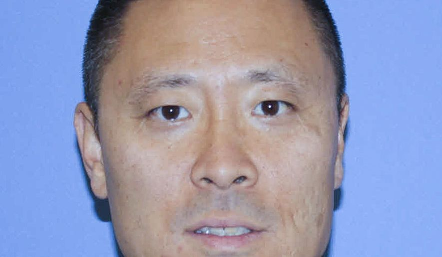 "This undated photo provided by the Cincinnati Police Department shows Officer Sonny Kim. Kim, a decorated 27-year veteran of the Cincinnati Police Department, Kim died June 19 after responding to a 911 call that police say the suspect made in an attempt at ""suicide by cop"".  Hamilton County prosecutor Joe Deters said Tuesday, Dec. 1, 2015, that he is wrapping up the investigation into the June fatal shootings of Kim and an armed suspect.  (Cincinnati Police Department via AP)"
