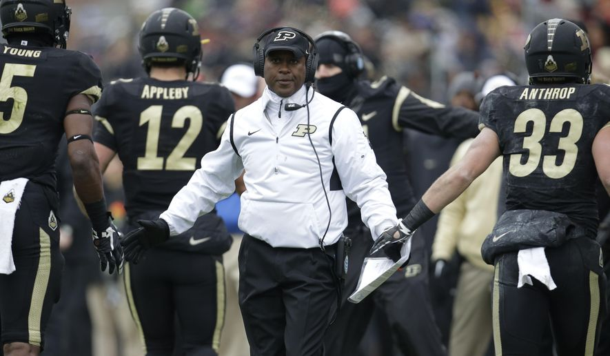 FILE - In this Nov. 28, 2015, file photo, Purdue head coach Darrell Hazell congratulates his players after a score against Indiana during the first half of an NCAA college football game in West Lafayette, Ind. Hazell has won six games in three years. He has three wins against FBS foes and two in Big Ten play. Empty seats have become the norm at Ross-Ade Stadium, and the school known as the Cradle of Quarterbacks has become a continual quarterback carrousel with six different starters since 2013.  (AP Photo/AJ Mast, File)