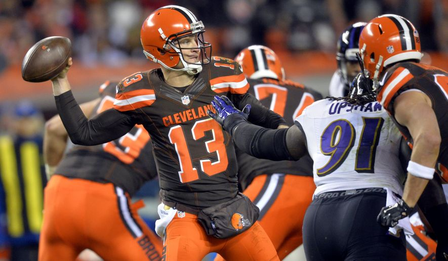 Cleveland Browns quarterback Josh McCown (13) throws in the first half of an NFL football game against the Baltimore Ravens, Monday, Nov. 30, 2015, in Cleveland. (AP Photo/David Richard)