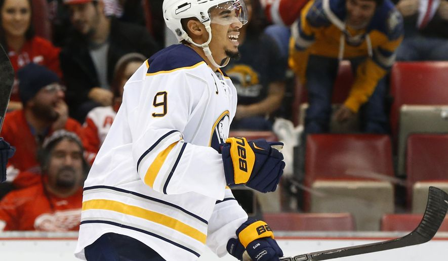 Buffalo Sabres left wing Evander Kane (9) celebrates his goal against the Detroit Red Wings in the first period of an NHL hockey game Tuesday, Dec. 1, 2015 in Detroit. (AP Photo/Paul Sancya)