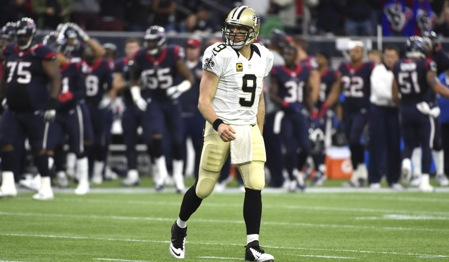 New Orleans Saints quarterback Drew Brees walks toward the bench after turning the ball over on downs to the Houston Texans during the fourth quarter of an NFL football game, Sunday, Nov. 29, 2015, in Houston. The Texans beat the Saints 24-6. (AP Photo/Eric Christian Smith)