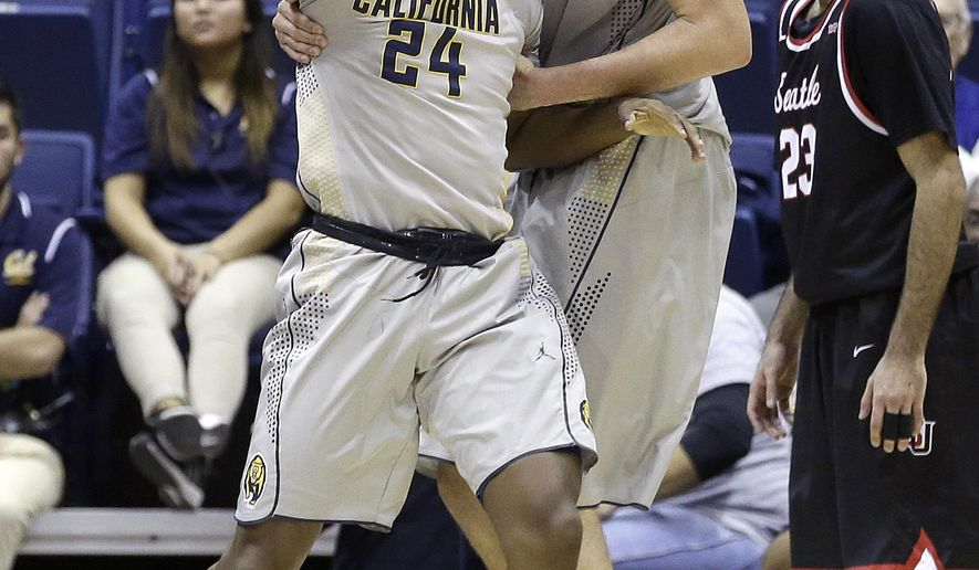 California guard Jordan Mathews (24) celebrates with center Kameron Rooks after scoring in front of Seattle guard Manroop Clair, right, during the second half of an NCAA college basketball game in Berkeley, Calif., Tuesday, Dec. 1, 2015. California won 66-52. (AP Photo/Jeff Chiu)