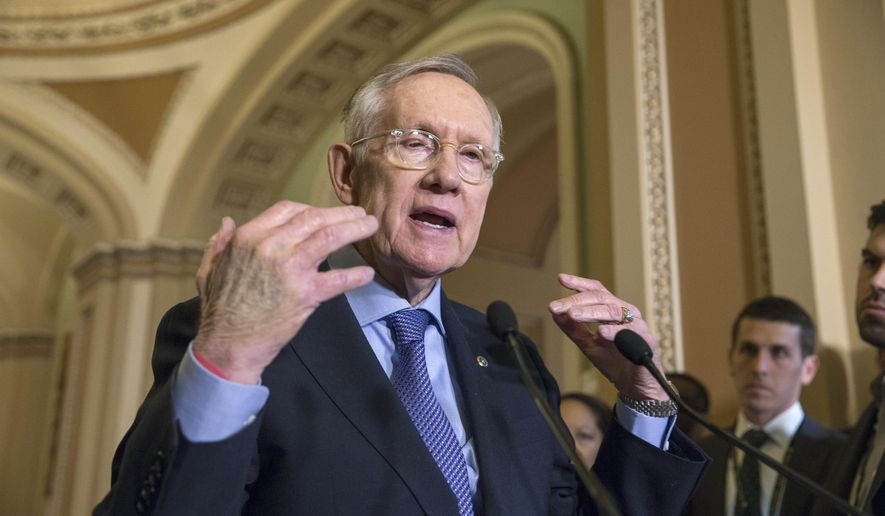 Senate Minority Leader Harry Reid of Nev. expresses his frustration with the Republican leadership during a news conference following a meeting on Capitol Hill in Washington, Tuesday, Dec. 1, 2015.    (AP Photo/J. Scott Applewhite)