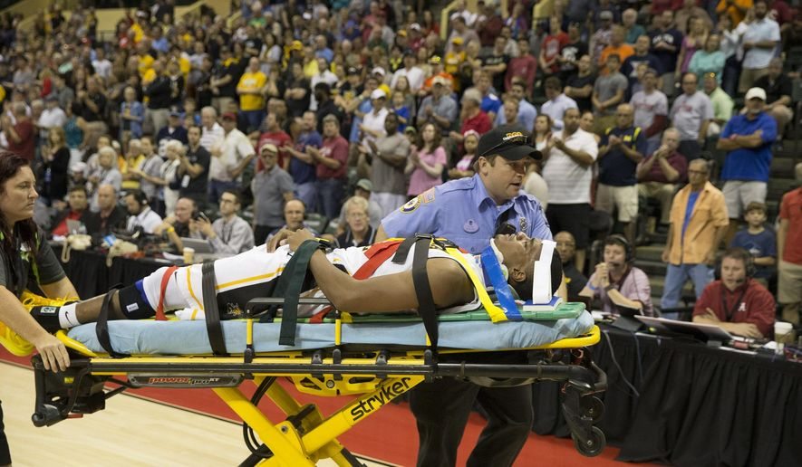 FILE - In this Nov. 27, 2015, file photo, Wichita State forward Anton Grady (15) is taken off the court after an injury during the second half of an NCAA college basketball game in Orlando, Fla. No college basketball team in the country has weathered more injuries during the first few weeks of the season than Wichita State, which tumbled out of the rankings after a near-unprecedented run of misfortune. (AP Photo/Willie J. Allen Jr., File)