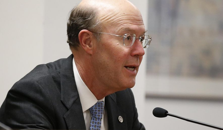 Bob Anthony, chairman of the Oklahoma Corporation Commission, speaks during a public comment period on a proposed plan by the state's largest utility to impose new costs on customers who install solar panels on their homes and businesses. (AP Photo/Sue Ogrocki)
